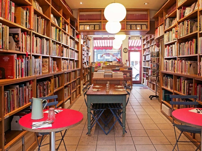 Curl Up With A Book And A Coffee In These Bookshop Cafes