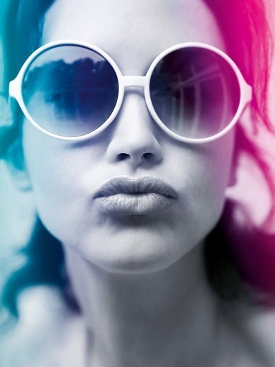 Pouting woman in rose tinted shades